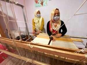 Women artisans from Ladakh making Pashmina clothing